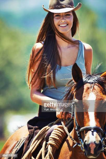 she's a natural rider - brown hat stock photos and pictures