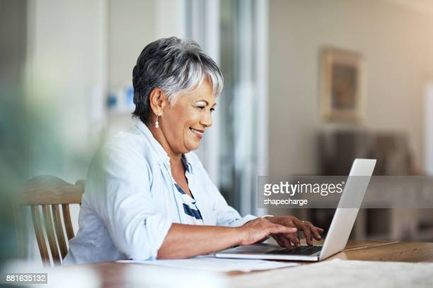 she's a pro when it comes to the finances - information equipment stock pictures, royalty-free photos & images