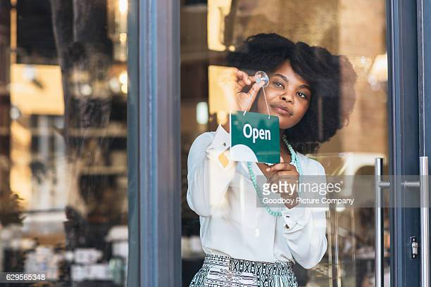 she's a proud business owner - open sign stock pictures, royalty-free photos & images