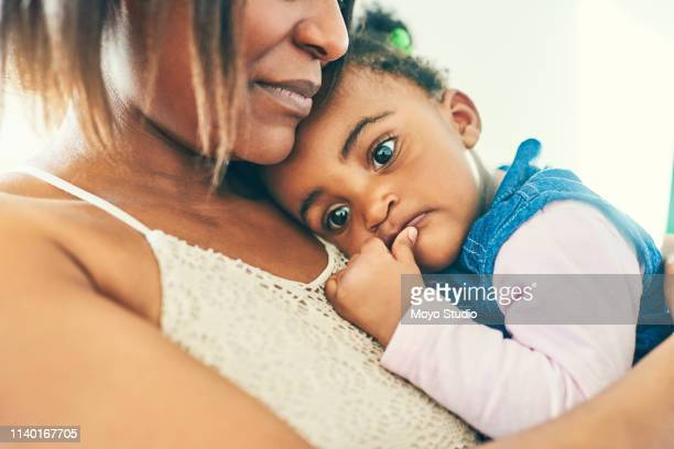 she's a sweet little one - sucking stock photos and pictures