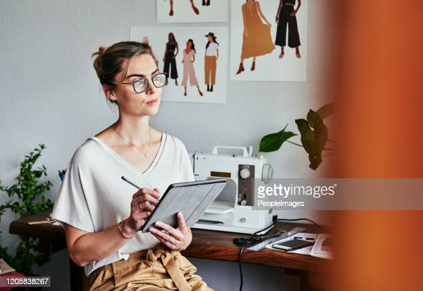 she's a true trendsetter - fashion designer stock pictures, royalty-free photos & images