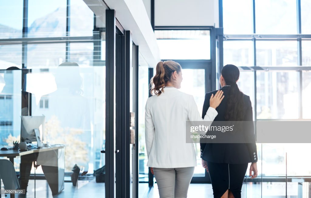 She's a warm and welcoming coworker : Stock Photo