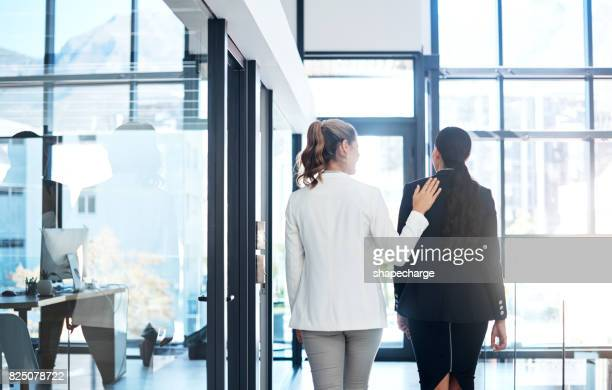 she's a warm and welcoming coworker - back to work stock pictures, royalty-free photos & images