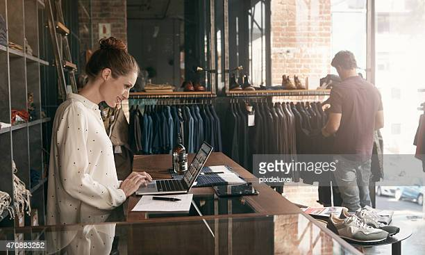 she's always one step ahead of the latest fashion trends - business owner stock photos and pictures