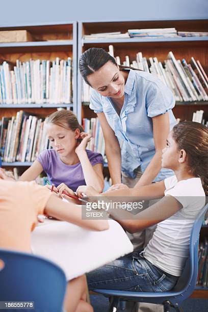 she's always there to help - teacher bending over stock photos and pictures
