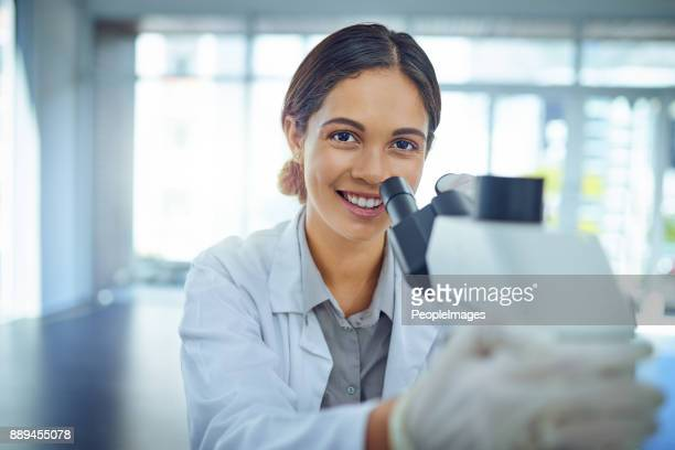 she's an expert at solving scientific mysteries - microscope stock pictures, royalty-free photos & images