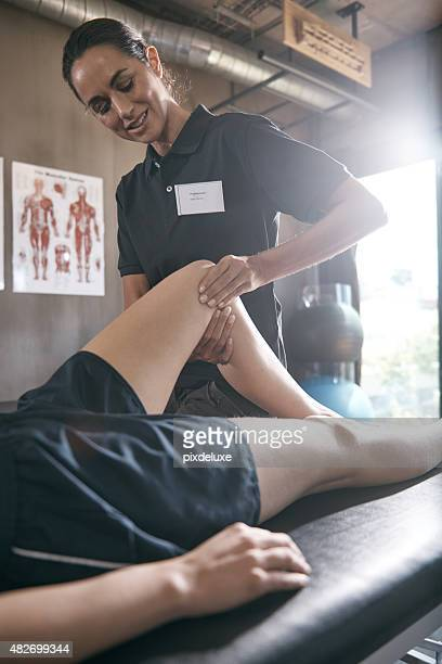she's an expert in pain relief - human muscle stock pictures, royalty-free photos & images