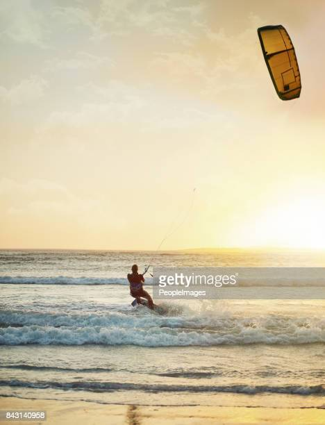 she's at one with the wind and waves - kiteboarding stock photos and pictures