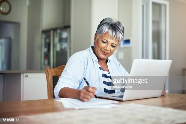 she's budgeted well - home finances stock photos and pictures