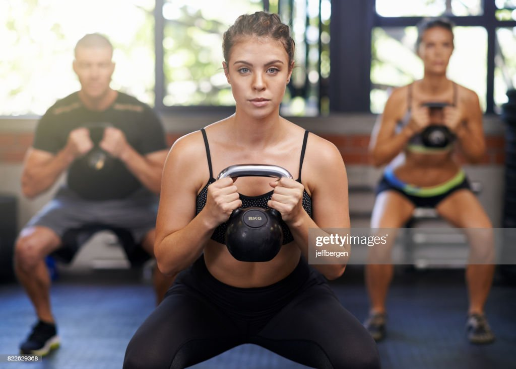 She's committed to their fitness : Stock Photo