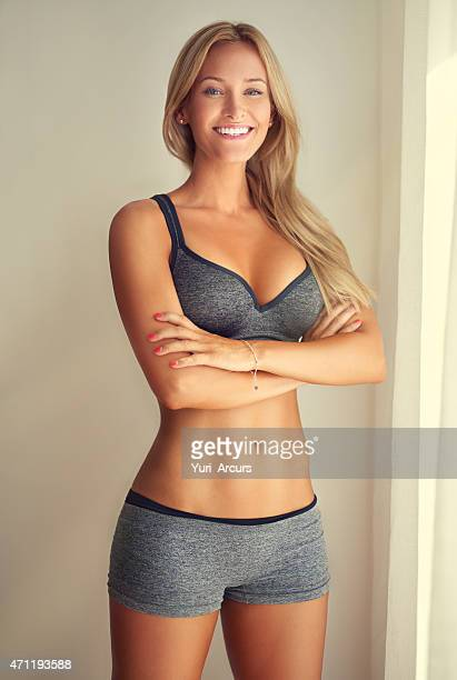 she's confident, and rightly so - skinny blonde stock photos and pictures