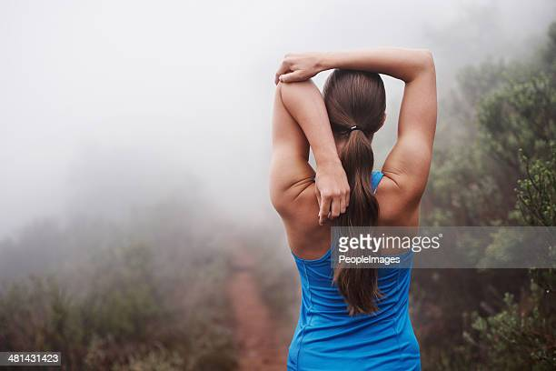 she's dedicated to her fitness - stretching stock photos and pictures