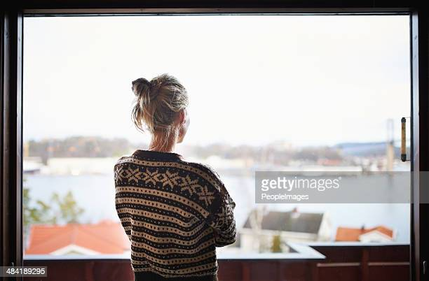 she's enjoying the view - looking through window stock pictures, royalty-free photos & images
