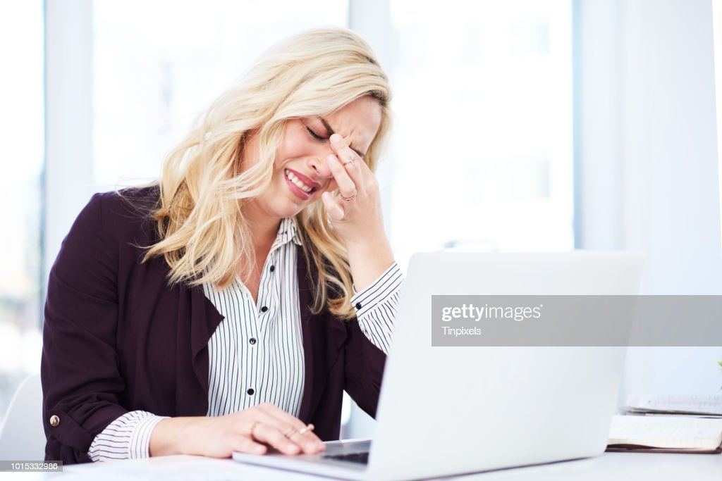 She's feeling the pressure of looming deadlines : Stock Photo