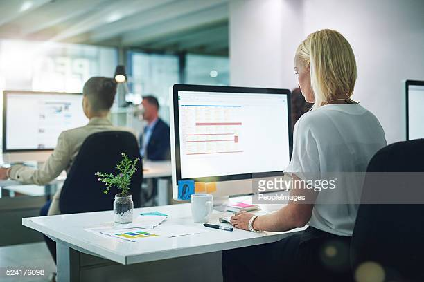 she's focused on the task at hand - using computer stock photos and pictures