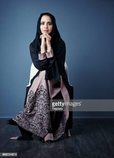 she's full of confidence and ambition - muslim woman darkness stock photos and pictures
