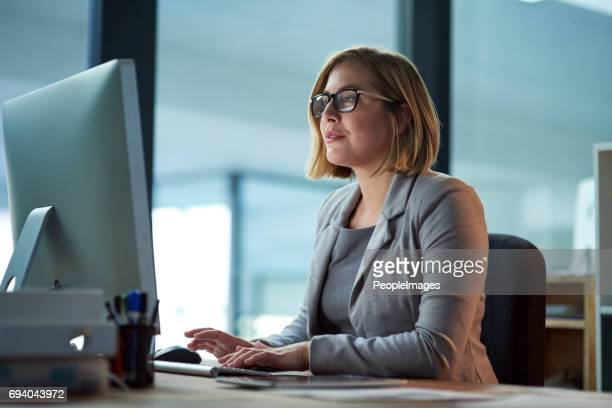 she's fully committed to the task at hand - using computer stock photos and pictures