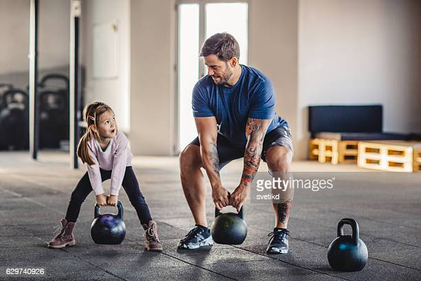 she's gonna be strong like daddy - crossfit stock pictures, royalty-free photos & images