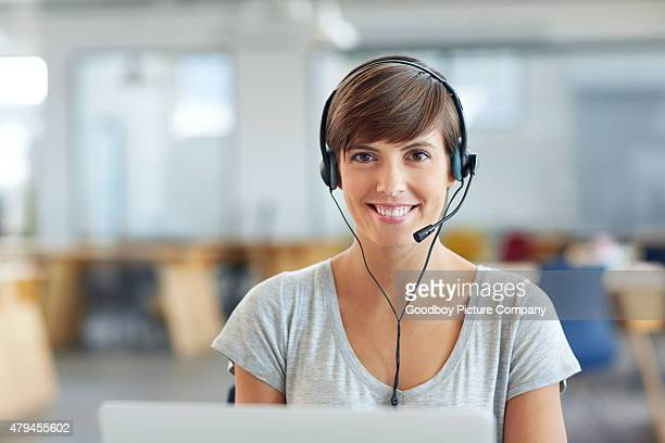 she's got a direct line to her customers - receptionist stockfoto's en -beelden