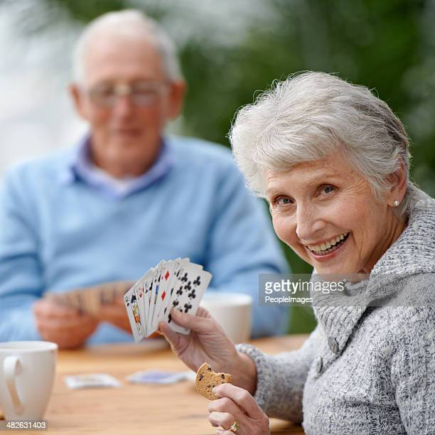 she's got a plan! - poker card game stock photos and pictures