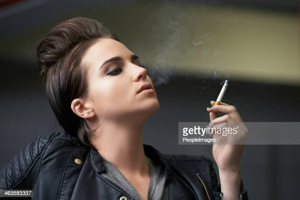 she's got an attractive attitude - beautiful women smoking cigarettes stock photos and pictures