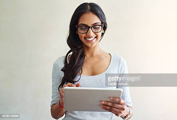 she's got everything she could need online - indian woman stock photos and pictures