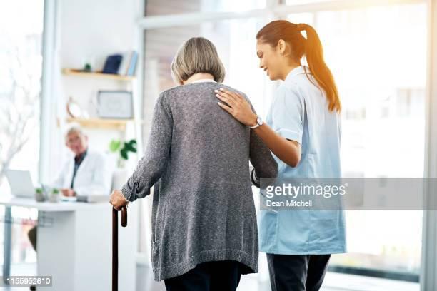 she's got her patient's backs - pazienza foto e immagini stock