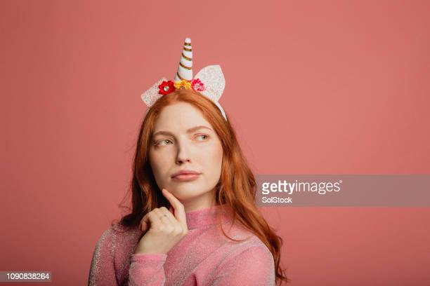 she's got her thinking cap on - unicorn stock pictures, royalty-free photos & images