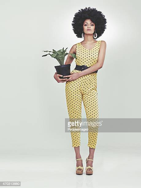 she's got style...and a plant. - african american 70s fashion stock photos and pictures