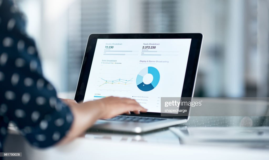 She's got the financial forecast right at her fingertips : Stock Photo