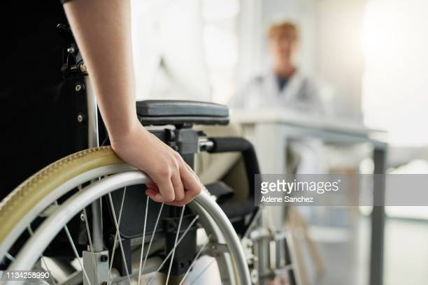 she's here for a second opinion - paraplegic stock photos and pictures