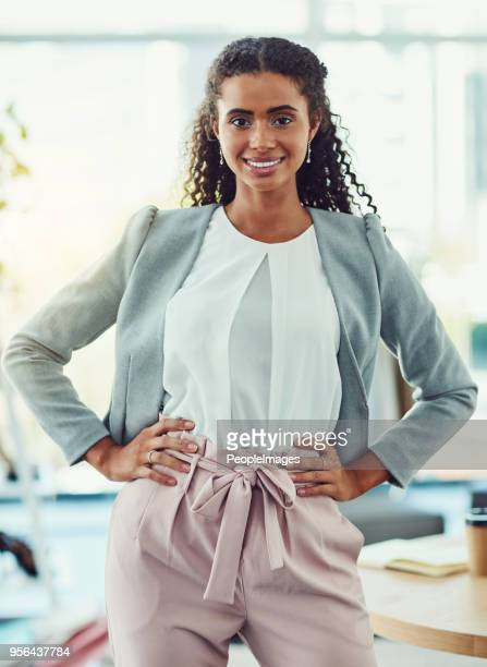 she's here to help any shopper in need - black blazer stock pictures, royalty-free photos & images