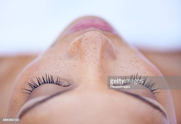 she's in a deeply relaxed state of mind - close up stock pictures, royalty-free photos & images