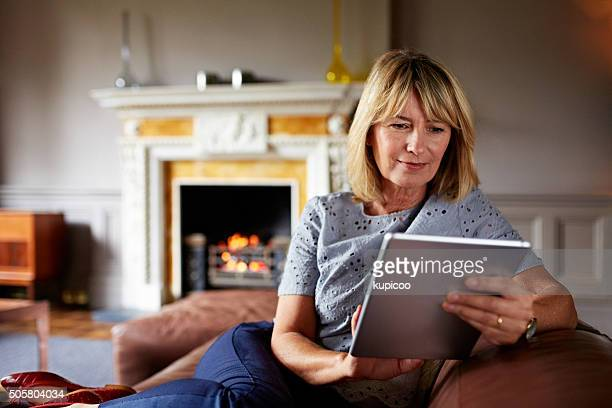 she's in touch with technology - hot older women stock pictures, royalty-free photos & images