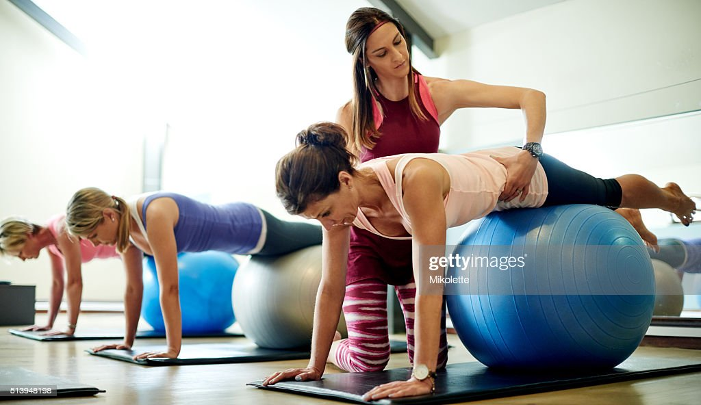 She's invested in her student's fitness : Stock Photo