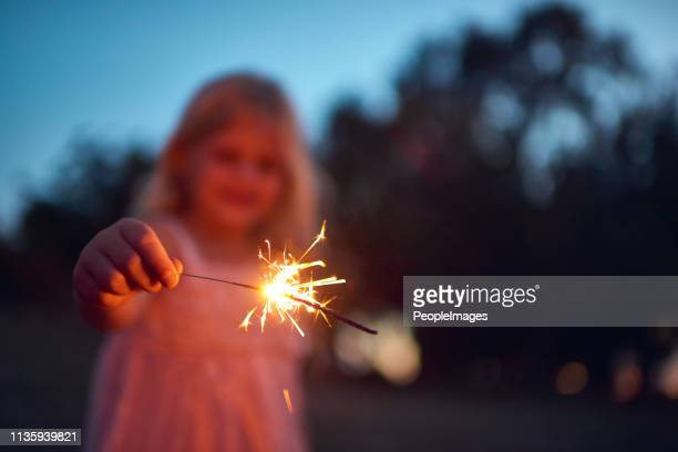 she's lighting up the night - sparkler stock pictures, royalty-free photos & images