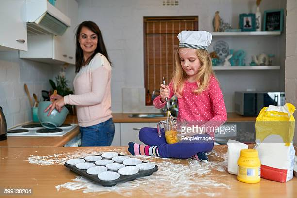 She's mommy's busy little baker