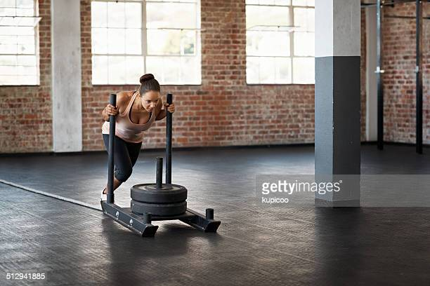 she's no push over - circuit training stock photos and pictures