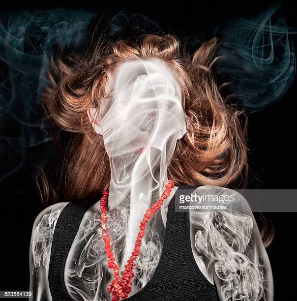 She's on fire - Ghastly smoke in excited young woman