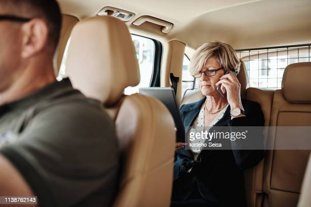 she's one important businesswoman - bodyguard stock pictures, royalty-free photos & images