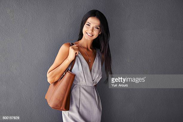 she's packing a purse and a smile - clutch bag stock pictures, royalty-free photos & images