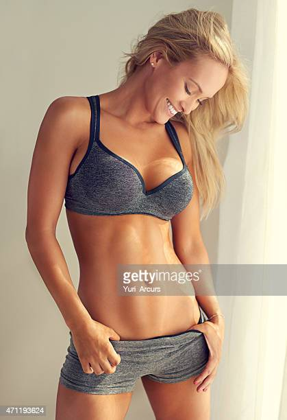 she's proud of her abs - torso stock pictures, royalty-free photos & images