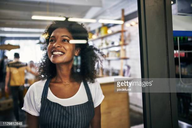 she's ready to open the doors - franchising stock pictures, royalty-free photos & images