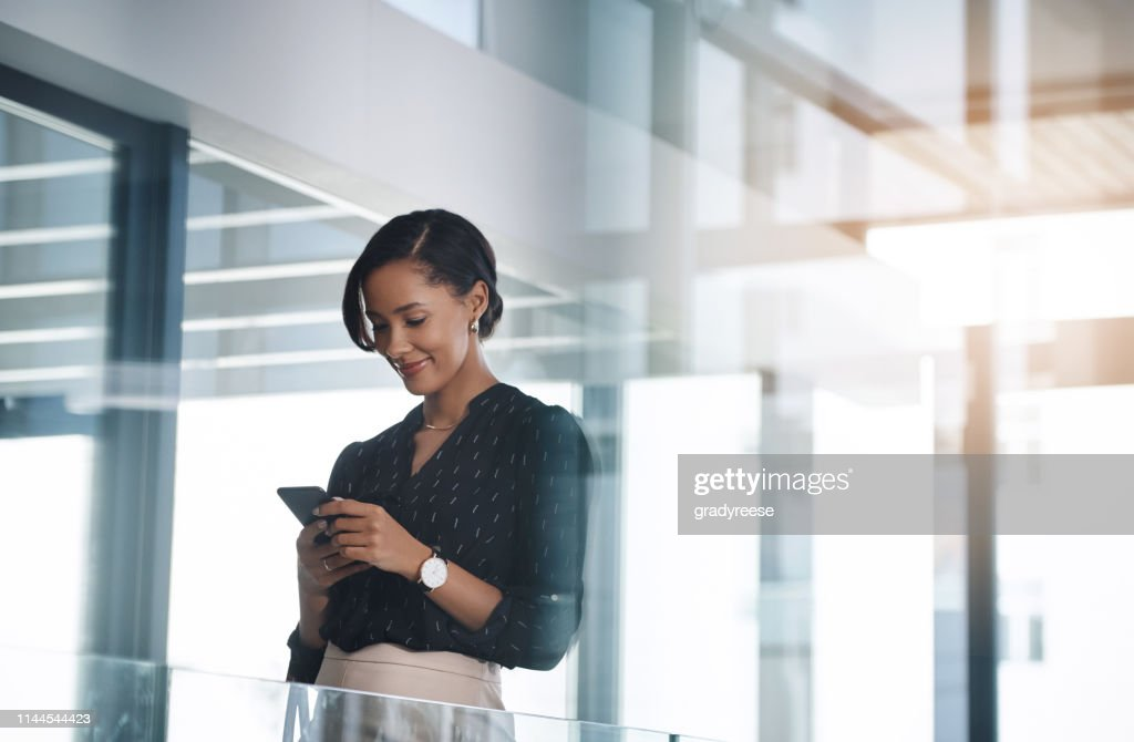 She's smart about the way she handles business : Stock Photo