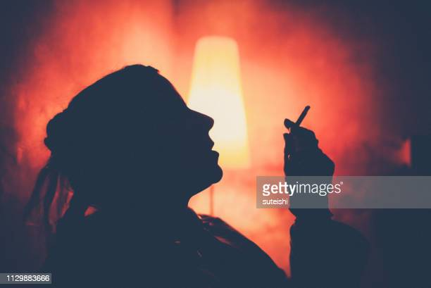 she's so cool - beautiful women smoking cigarettes stock pictures, royalty-free photos & images