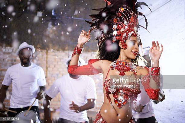 she's the beauty to their music - brazilian carnival stock pictures, royalty-free photos & images