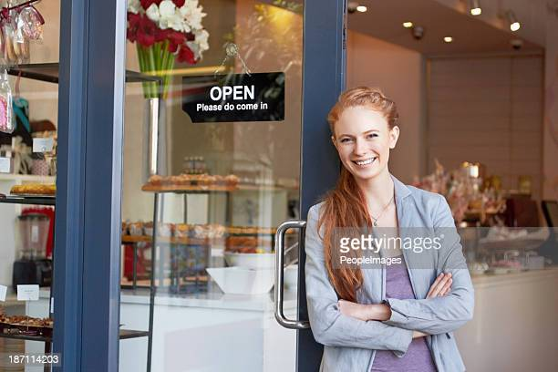 she's the proud owner of this bakery - doorway stock pictures, royalty-free photos & images
