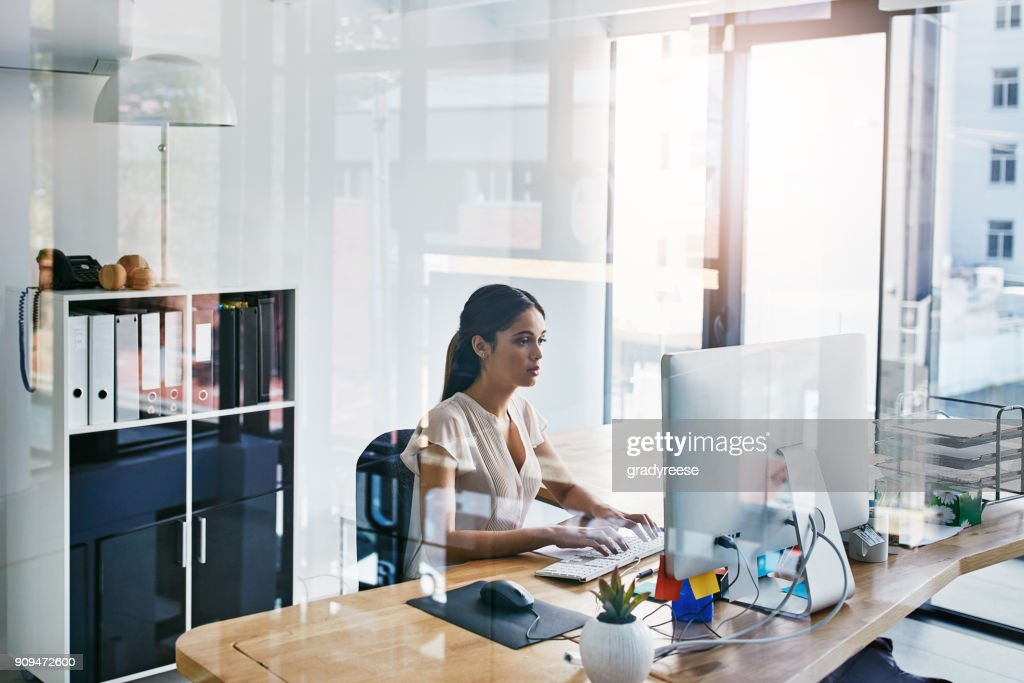 She's very thorough in completing tasks : Stock Photo