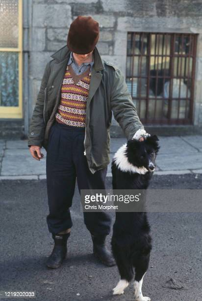 A Shetlander wearing a traditional Fair Isle pattern sweater with a collie dog in Lerwick Mainland Shetland Scotland June 1970