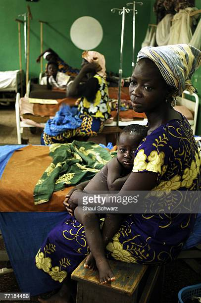 Shetu Adamui holds her ser son Joshua Jaeaan who has been infected with malaria as his legs still show the mosquito bites September 18 2007 in the...
